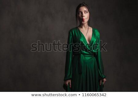Brunette femme longtemps vert bal robe Photo stock © feedough