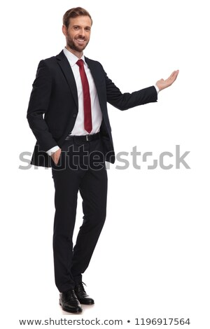 businessman stands with hand in pocket and presents to side Stock photo © feedough