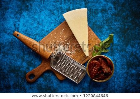 Parmesan métal classique râpe bois planche à découper Photo stock © dash