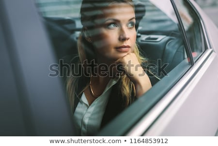 Woman Looking Out Of Car Window Stock photo © AndreyPopov