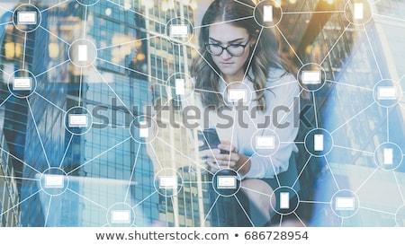 Young businesswoman in innovative blockchain concept Stock photo © Elnur