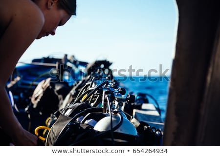 Scuba diving equipments in yellow and blue color Stock photo © colematt