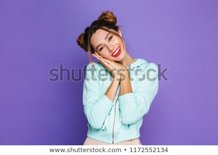 Image of adorable woman with two buns smiling and putting hands  Stock photo © deandrobot