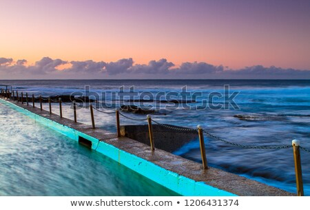 Sunrise from the Sydney Coast with foregrund rock pools Stock photo © lovleah
