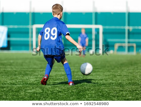 Group of Young Boys in Soccer Sportswear Kicking Ball stock photo © matimix