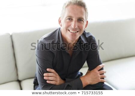 Portret 40s człowiek posiedzenia sofa domu Zdjęcia stock © Lopolo