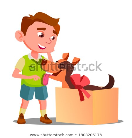 happy little boy takes out of gift box a dog vector isolated illustration stock photo © pikepicture