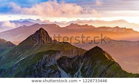 Alpok naplemente díszlet égbolt sport hó Stock fotó © unkreatives