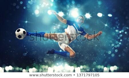 Futebol bola acrobático chutá ar escuro Foto stock © alphaspirit