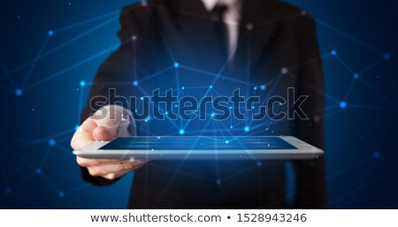 Stock photo: Hand in a dark space with virtual workspace concept