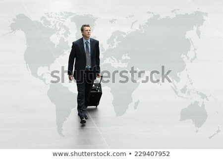 Businessman going to business trip with map Stock photo © ra2studio