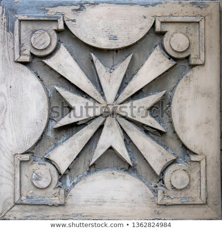 Traditional Maltese cross on the facade of old building in Gozo, Stock photo © boggy