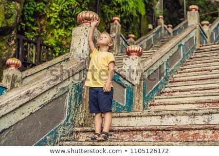 Boy in the background of Batu Caves, near Kuala Lumpur, Malaysia. Traveling with children concept Stock photo © galitskaya