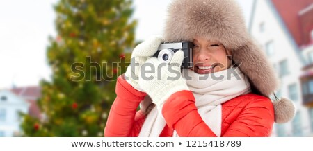 woman with camera over christmas tree in tallinn Stock photo © dolgachov
