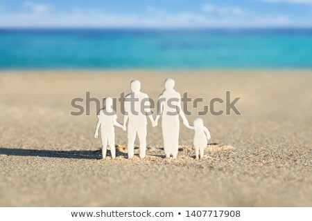 Human Figure Paper Cut Out On Sand At Beach Stock photo © AndreyPopov