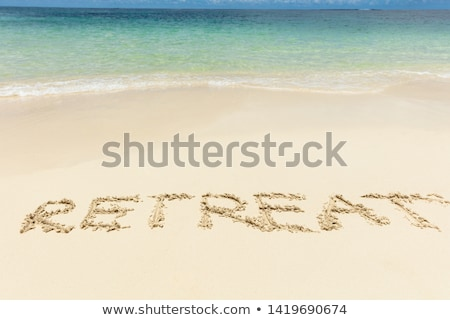 Retreat Text On Sand Near The Idyllic Sea At Beach Stock photo © AndreyPopov