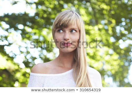 Thoughtful young blond woman glancing sideways stock photo © Giulio_Fornasar
