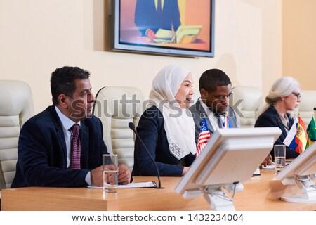 Young Muslim woman in white hijab making speech Stock photo © pressmaster