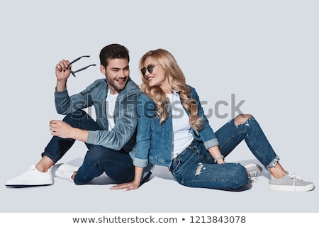 confident man in jeans smiling stock photo © nyul