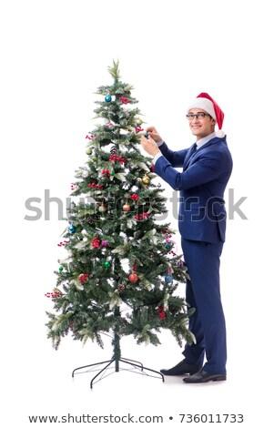 Businessman decorating christmas tree isolated on white Stock photo © Elnur