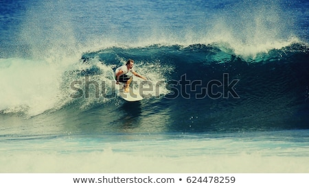 Surfer on the wave, catches a wave, surfing in the pipe. Surfing in the ocean on the island of Bali, Stock photo © galitskaya