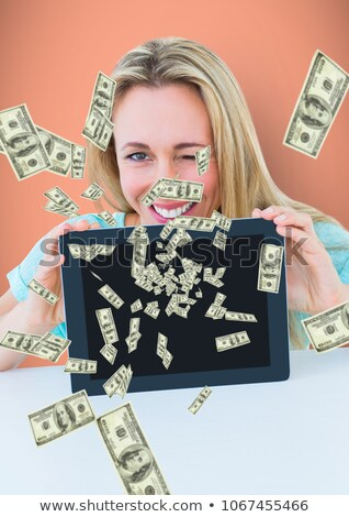 texting money happy woman with tablet money coming up from tablet stock photo © wavebreak_media