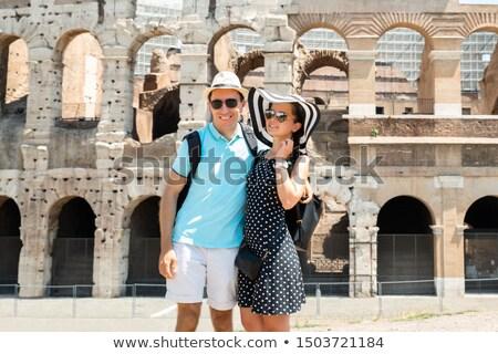 Pie coliseo jóvenes turísticos Pareja Foto stock © AndreyPopov