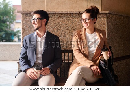 Two restful females in smart casual having drinks while relaxing outdoors Stock photo © pressmaster