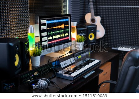 Electrical equipment for recording and computer monitor on workplace of deejay Stock photo © pressmaster