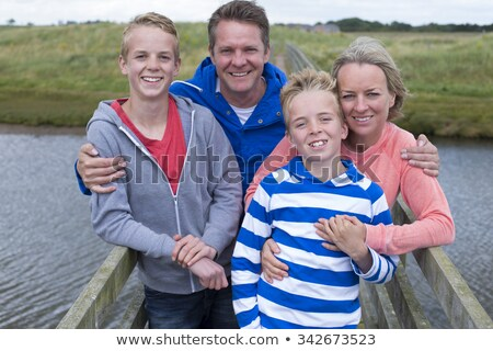 family having fun on a small bridge stock photo © lopolo