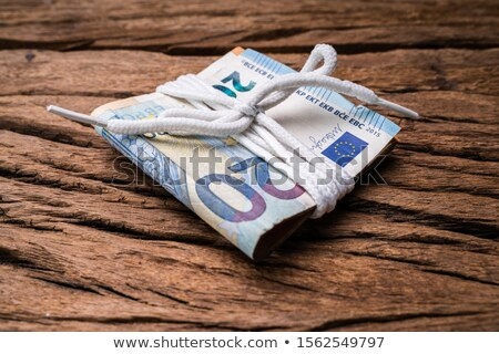 Euro Currency Notes Tied With Lace Over Wooden Backdrop Stock photo © AndreyPopov