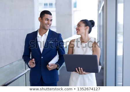 front view of beautiful happy young mixed race business people interacting with each other standing stock photo © wavebreak_media