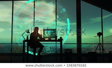 Silhouette of a photographer working with a holographic projection. Stock photo © ConceptCafe