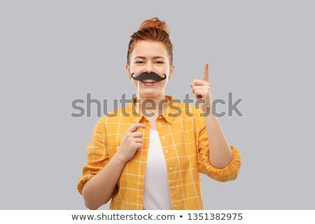 teenage girl with moustaches pointing finger up Stock photo © dolgachov