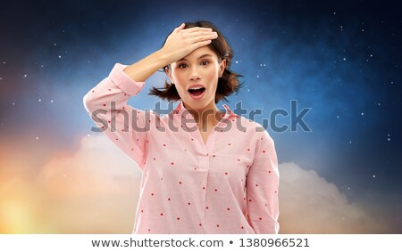 confused young woman in pajama over night sky Stock photo © dolgachov