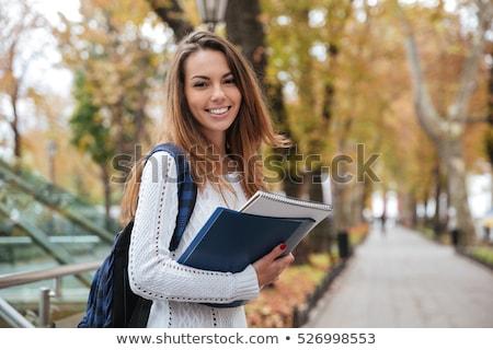 Foto stock: Belo · jovem · feminino · estudante · estudar · biblioteca