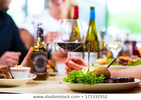 People Couple Eating in Restaurant Eatery or Diner Stock photo © robuart