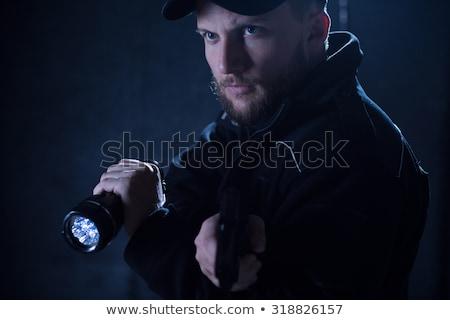 Security Guard Uniform Using Flashlight At Night Stock photo © AndreyPopov