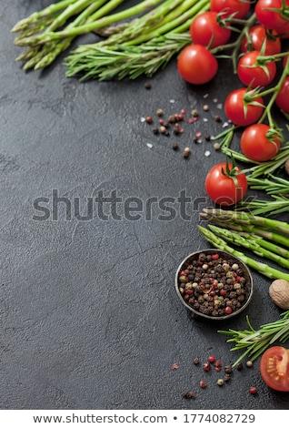 Fekete étel spárga koktélparadicsom rozmaring tál Stock fotó © DenisMArt