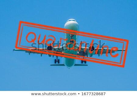 Quarantine due to coronavirus epidemic covid19 Modern airplane in the sky near Airport. takes off or Stock photo © galitskaya