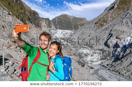 Selfie couple taking phone self-portrait on New Zealand by Franz Josef Glacier Stock photo © Maridav