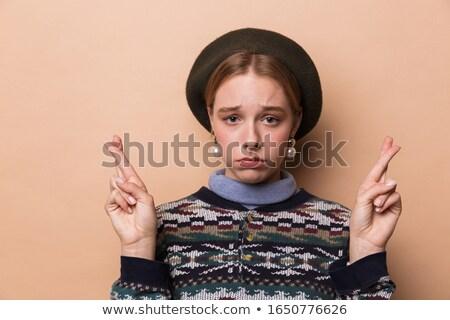 Fotoğraf güzel mutsuz kadın poz parmaklar Stok fotoğraf © deandrobot