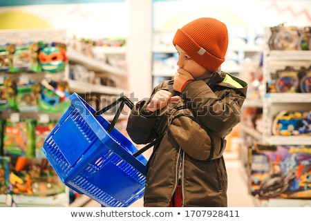 boy looks at shelves with toys in shop stock photo © paha_l