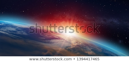The sun and the earth in space  Stock photo © DuToVision