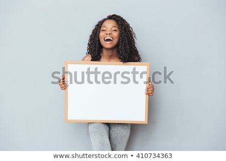 happy african american woman holding business card stock photo