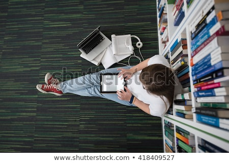 Pretty Female College Student Studying In The University Library Сток-фото © dotshock