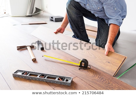 Man renovating the floor with wood panels Stock photo © photography33