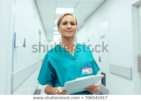 portrait of female nurse in hospital corridor Stock photo © photography33