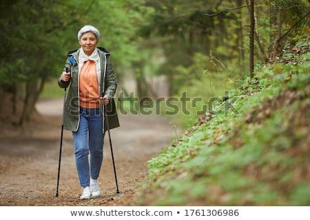 kıdemli · kadın · yaprakları · yürümek · sonbahar · yaprakları - stok fotoğraf © photography33