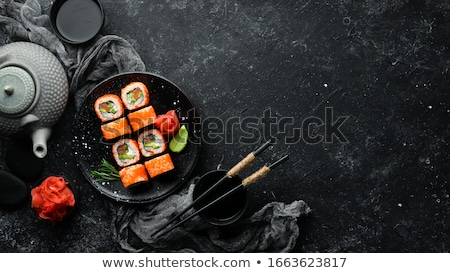 Sushis plat blanche rouge baguettes alimentaire Photo stock © stevemc